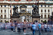 "Crowds in-front of the Wrestling Titans (Sousoší Souboj Titánů), also known as Fighting Giants and Giants' Gate, which are pair of outdoor sculptures leading to the first courtyard of Prague Castle at ""Hradcany Square"" (Hradcanske Namesti)."