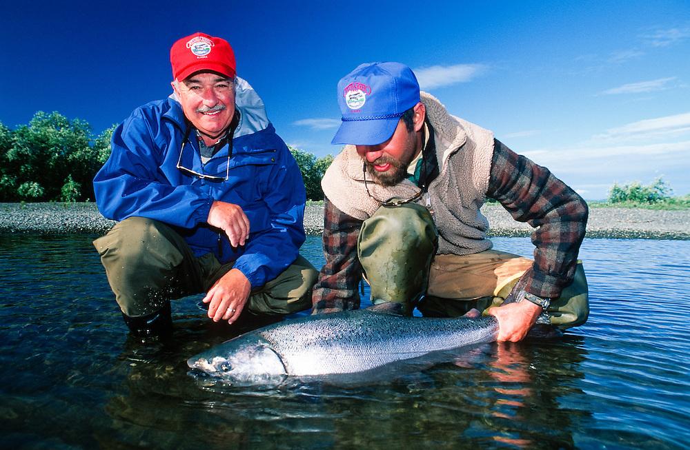 Alaska. Crystal Creek Lodge guest with king salmon.