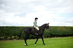 © Licensed to London News Pictures.29/07/15<br /> Borrowby, UK. <br /> <br /> A rider and her horse warm up around the practice ring before her round of jumps during competition at the Borrowby Country Show and Gymkhana in North Yorkshire.<br /> <br /> Photo credit : Ian Forsyth/LNP
