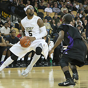Central Florida guard Marcus Jordan (5) drives the ball against Furman guard Richard Brown (3) during an NCAA basketball game at the UCF Holiday Classic at the UCF Arena on December 29, 2010 in Orlando, Florida. (AP Photo/Alex Menendez)