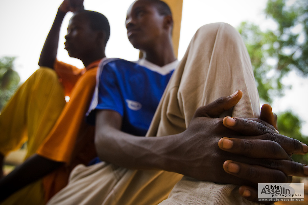 Baimba Sesay and his cousin Ibrahim Sesay, both 15, in the town of Makeni, Sierra Leone, on Friday February 27, 2009. The boys were arrested and spent 6 days in jail after being caught stealing goods from a catholic mission. They say friends came to ask them for help to carry the goods, but that they were unaware that they were in fact stealing them. When the police showed up, their friends ran away, but Baimba and Sesay, not knowing what was going on, stayed put and got caught. Their family paid the bail, both boys are now attending school.