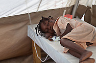 Slyvie Lafoir, 8 years old being treated  at Martissant 25 , a cholera treatment center in Port-au-Prince run by Doctors without Boarders (MSF) that treats hundreds of cholera patients a day.