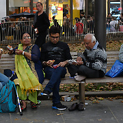 People eating Leicester Square, Chinatown London, UK