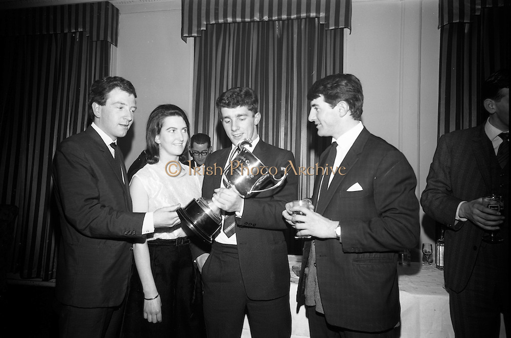 16/2/1966<br /> 2/16/1966<br /> 16 February 1966<br /> <br /> (L-R) Jimmy O'Leary(Marino) Alice Joyce(Ballyfermot) Norman Caprani (Dublin) and Michael McDonnell(Glasnevin) admiring the trophy at the All Ireland Judo Championship at the Jury Hotel
