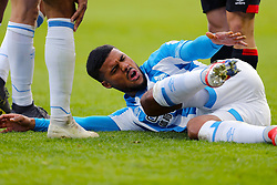 Huddersfield Town's Elias Kachunga lies injured on the pitch during the Premier League match at the John Smith's Stadium, Huddersfield.