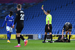 Brighton and Hove Albion's Yves Bissouma (left) is shown a yellow card by referee Andre Marriner for a foul on West Ham United's Jesse Lingard (right) during the Premier League match at the American Express Community Stadium, Brighton. Picture date: Saturday May 15, 2021.