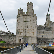 A modern drawbridge across the River Seiont at Caernarfon Castle in northwest Wales. A castle originally stood on the site dating back to the late 11th century, but in the late 13th century King Edward I commissioned a new structure that stands to this day. It has distinctive towers and is one of the best preserved of the series of castles Edward I commissioned.