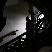 A monk in the granite staircase called de Juigné serving the cells and the infirmary. Solesmes on 17-10-2019<br /> Un moine dans l'escalier de granit dit de Juigné desservant les cellules et l'infirmerie. Solesmes le 17-10-2019