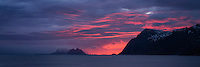 Pink clouds at sunset over Værøy islands from near Å I Lofoten, Moskenesøy, Lofoten Islands, Norway
