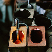 Containers of dye used for coloring clothing in the market at Lucknow, Uttar Pradesh, India