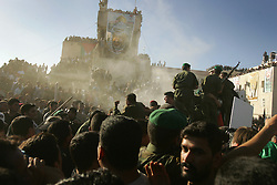 Palestinians crowd around the car taking the body of Yasser Arafat to his grave, Ramallah, Palestinian Territories, Nov. 12, 2004. Arafat died in a Paris hospital at the age of 75.