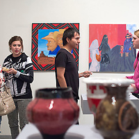 From left, Stefanie Mortensen, Brianna Mortensen, Shane Sanderson and Maria Oliver-Chavez walk around the Spring Student Show at the Ingham Chapman Gallery in the University of New Mexico Gallup Campus Monday. The collection includes works by fine art studio students in all mediums.