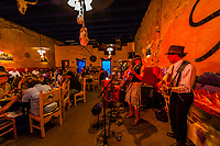 Local musicians performing during dinner at the Starlight Theatre Restaurant and Bar, Terlingua Ghosttown, near Big Bend National Park, Texas USA.