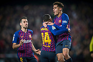 Malcom of FC Barcelona ,celebrates his goal of the draw,with Coutinho (right) and Sergio Busquets (left),during the first match of the Spanish King's Cup semifinal at Camp Nou Stadium in Barcelona,Spain,6 February 2019