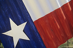Close up of Texas flag painted onto a sheet of metal