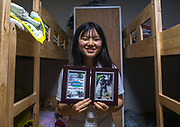 EXCLUSIVE<br /> A DEFECTOR'S LIFE IN SOUTH KOREA<br /> <br /> Kim is 16 years old and lives in Seoul, South Korea. She looks like any other teenager when you see her shopping in the street. But like 28,000 other refugees, she has escaped from North Korea.One morning in 2011, her mother could no longer bear the misery, lack of freedom and food deprivation, so she and her daughter escaped to seek refuge in the wealthy ultra-modern South Korea. Kim was 10 and had to leave the rest of her family, her friends and her school without even having the chance to say goodbye.<br /> They fled their country in secret by crossing on foot and by night the river making up the border with China. Their journey to reach South Korea took eight long months. After making it to China, her mother used her meager savings to pay smugglers to enter Laos, Thailand and finally South Korea. They arrived in the Land of Morning Calm in 2012.<br /> <br /> Photo shows:  There are no pictures of her family in North Korea. She lost everything while crossing the icy river to enter China. The only picture in her possession shows her during a military training in Seoul.<br /> ©Eric Lafforgue/Exclusivepix Media