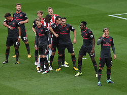 19 August 2017  : Premier League Football : Stoke City v Arsenal: Mesut Ozil (far right) stands in an Arsenal zonal marking formation:<br />  Photo: Mark Leech