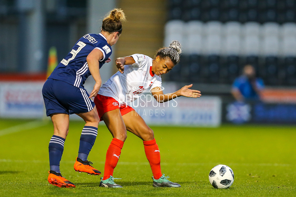 Emma Mitchell (#3) of Scotland clears the ball againstEseosa Aigbogun (#19) of Switzerland during the 2019 FIFA Women's World Cup UEFA Qualifier match between Scotland Women and Switzerland at the Simple Digital Arena, St Mirren, Scotland on 30 August 2018.