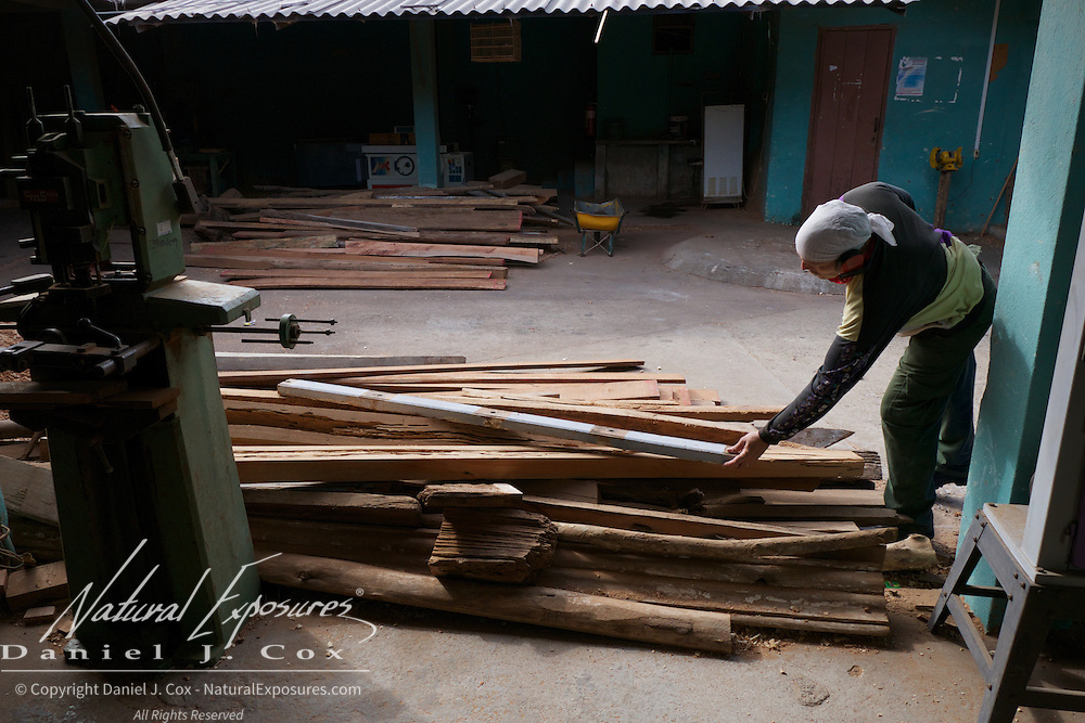Young man working in a local lumber yard, Trinidad, Cuba.