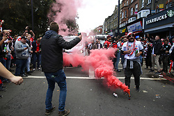 14 September 2017 -  UEFA Europa League (Group H) - Arsenal v FC Koln - FC Koln fans dance in the street on Highbury Corner around a red flare - Photo: Mark Leech/Offside