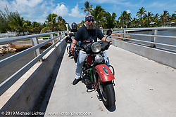Matt Miller riding his 1947 Harley-Davidson Model U Flathead in the Cross Country Chase motorcycle endurance run from Sault Sainte Marie, MI to Key West, FL. (for vintage bikes from 1930-1948). The staging area on a Key West pier just before the finish and near the end of the 110 mile Stage-10 ride from Miami to Key West, FL USA. Sunday, September 15, 2019. Photography ©2019 Michael Lichter.