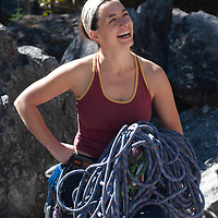Rachel Ludwig prepares for rock climb on Rundle Rock near town of Banff in Alberta's Banff National Park, Canada.
