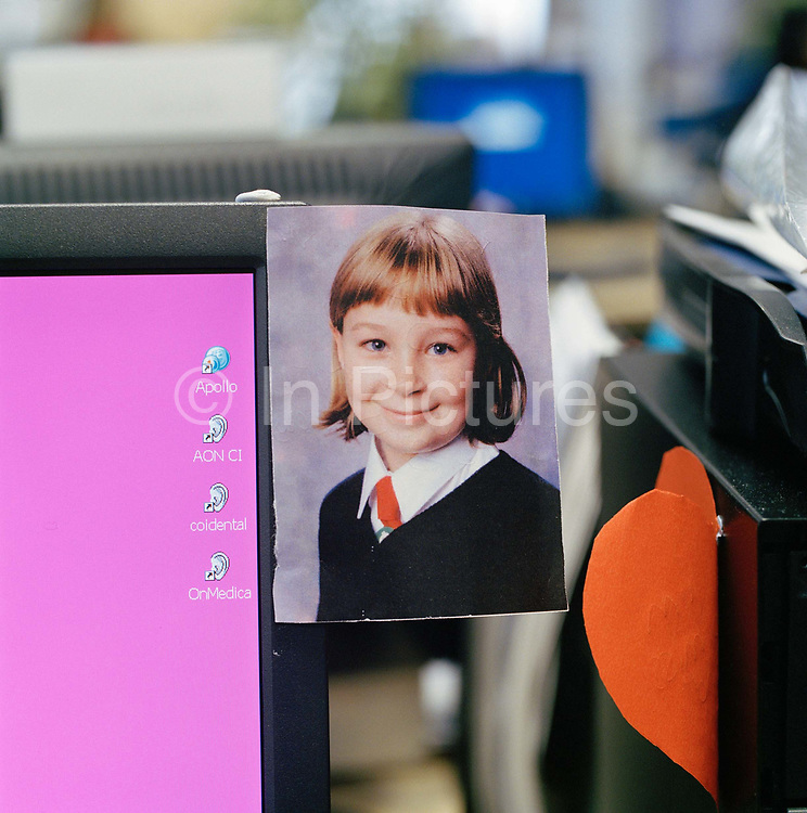 Michael Hodgkinsons desk showing a photograph of his daughter Rosanna. Being allowed to personalise ones desk space is a pleasure not enjoyed by all workers, some offices choose to outlaw the clutter that comes with personalisation. From the series Desk Job, a project which explores globalisation through office life around the World.
