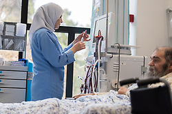 24 February 2020, Jerusalem: Practical Nurse Muyassar Ismail tends to Dialysis patient Amilio Alvi at Augusta Victoria Hospital.