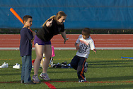 Middletown, New York - Children play baseball with Middletown High School athletes at Faller Field during Family Fun Night on May 17, 2013.