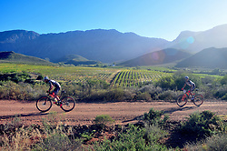 ROBERTSON, SOUTH AFRICA - MARCH 20: Riders during stage two's 110km from Robertson on March 20, 2018 in Cape Town, South Africa. Mountain bikers from across South Africa and internationally gather to compete in the 2018 ABSA Cape Epic, racing 8 days and 658km across the Western Cape with an accumulated 13 530m of climbing ascent, often referred to as the 'untamed race' the Cape Epic is said to be the toughest mountain bike event in the world. (Photo by Dino Lloyd)