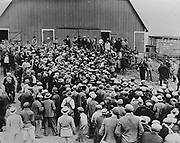 Depression in the United States, early 1930s.  A foreclosure sale in Iowa brought about by inflation.  Military police are in attendance to control farmers intent on stopping the auction. America