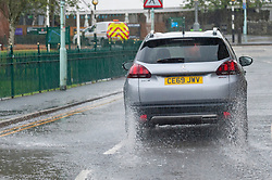 © Licensed to London News Pictures.28/09/2021. Builth Wells, Powys, Wales, UK. Motorists drive through heavy rain in Builth Wells in Powys, Wales, UK. Photo credit: Graham M. Lawrence/LNP