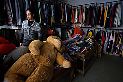 A Palestinian woman is seen in her shop in the Sabra and Shatila neighborhood in Beirut, Lebanon, March, 17, 2006. On Sept. 16, 1982, what is considered one of the worst atrocities of the civil war happened in this refugee camp. Militants from the Lebanese Forces, with help from the Israeli military, closed off the Palestinian quarters of the Sabra and Shatila refugee camps and killed up to 2,000 Palestinian civilians over three days. Today there are 12 official refugee camps scattered across Lebanon housing some 400,000 Palestinian refugees.