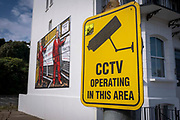 CCTV operating next to Respect Road 2020 by artists Gilbert & George, one of six images that will be displayed as billboards for the Creative Folkestone Triennial 2020, The Plot on 20th of July 2021, in Folkestone, United Kingdom. Folkestones 5th open air art exhibition The Plot sees 27 newly commissioned artworks appearing around the south coast seaside town. The new work builds on the work from previous triennials making Folkestone the biggest urban outdoor contemporary art exhibition in the UK.