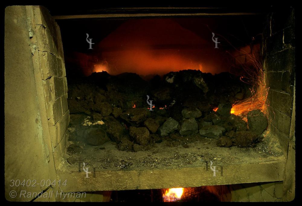 Peat and coal burn in malt kiln oven at Highland Park Distillery; Kirkwall, Orkney Islands. Scotland