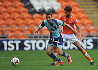 Wycombe Wanderers' Nick Freeman shields the ball from Blackpool's Kelvin Mellor<br /> <br /> Photographer Bethany Hankey/CameraSport<br /> <br /> Football - The EFL Sky Bet League Two - Blackpool v Wycombe Wanderers - Saturday 20 August 2016 - Bloomfield Road - Blackpool<br /> <br /> World Copyright © 2016 CameraSport. All rights reserved. 43 Linden Ave. Countesthorpe. Leicester. England. LE8 5PG - Tel: +44 (0) 116 277 4147 - admin@camerasport.com - www.camerasport.com