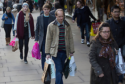 © licensed to London News Pictures. London, UK 16/12/2012. People shopping on Oxford Street in London on the second last weekend until the Christmas. Photo credit: Tolga Akmen/LNP