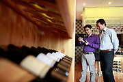 Lin Tiangui, a representative of Winston Wine, train a sales cleark at one of its stores in Shanghai, China on 18 October, 2011. Photographer: Qilai Shen/BloombergLin Tiangui, a representative for Australia's Winston Wines Pty, examines a bottle of wine with a staff member at the company's store in Shanghai, China, on Tuesday, Oct. 18, 2011. Australian vineyards, facing slumping exports and rising competition, are turning to China as Chinese buyers creating surging demand among the nation's rich, who are developing a taste for wine and the expression of wealth and class it conveys.