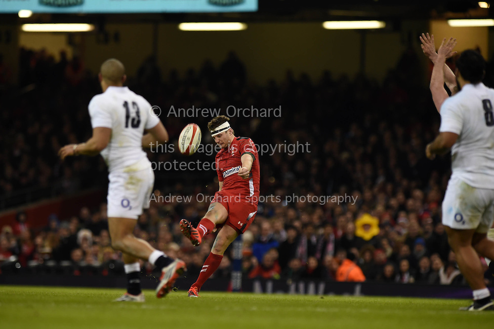 Dan Biggar of Wales kicks a drop goal just before half time, RBS Six nations championship 2015, Wales v England at the Millennium Stadium in Cardiff, South Wales on Friday 6th  Feb 2015. pic by Andrew Orchard, Andrew Orchard sports photography.