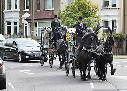 © Licensed to London News Pictures. 04/09/2016. London, UK. A horse drawn procession carrying brothers Kenigan and Kobi Nathan takes to the road after a joint funeral held at Winn's Common Park for five men who drowned at Camber Sands last month.  The five men: Kurushanth Srithavarajah, brothers  Kenigan and Kobi Nathan, Inthushan Sri and Nitharsan Ravi were all friends from London.  They got into difficulty in the sea of Camber Sands on August 24. Photo credit: Peter Macdiarmid/LNP