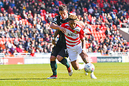 Mallik Wilks of Doncaster Rovers (7) and Niall Canavan of Plymouth Argyle (14) in action during the EFL Sky Bet League 1 match between Doncaster Rovers and Plymouth Argyle at the Keepmoat Stadium, Doncaster, England on 13 April 2019.