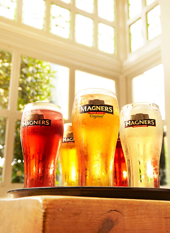 Glasses filled with Magners cider in a tray on a table Ray Massey is an established, award winning, UK professional  photographer, shooting creative advertising and editorial images from his stunning studio in a converted church in Camden Town, London NW1. Ray Massey specialises in drinks and liquids, still life and hands, product, gymnastics, special effects (sfx) and location photography. He is particularly known for dynamic high speed action shots of pours, bubbles, splashes and explosions in beers, champagnes, sodas, cocktails and beverages of all descriptions, as well as perfumes, paint, ink, water – even ice! Ray Massey works throughout the world with advertising agencies, designers, design groups, PR companies and directly with clients. He regularly manages the entire creative process, including post-production composition, manipulation and retouching, working with his team of retouchers to produce final images ready for publication.