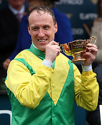 Jockey Robbie Power celebrates with the Timico Gold Cup after his winning ride on Sizing John in the Timico Cheltenham Gold Cup Chase during Gold Cup Day of the 2017 Cheltenham Festival at Cheltenham Racecourse.