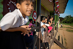 NO WEB/NO APPS - Exclusive. (Text available) Children wait for the beginning of the lessons at their school in 'Palma Real' native community, near Puerto Maldonado, Peru on July 17, 2017. The Amazon rainforest is famous as 'The Lung of the Earth', but also for the presence of numerous native communities, who have always lived isolated and in close contact with nature for generations, used to seek for food and medicines and to build items directly from the environment in which they live. The unstoppable rise of globalization has drastically changed their needs, expectations and consequently their way of life. Located in the Tambopata National Reserve, on the border between Peru and Bolivia, the native Comunidad Palma Real is one of the clearest examples of this change. Living on the banks of the Madre de Dios River since approximately 1976, Palma Real comprises about 300 people part of the nomadic community Ese-Eja, established in the Amazon rainforest of Peru before the Spanish colonization. Photo by Giacomo d'Orlando/ABACAPRESS.COM