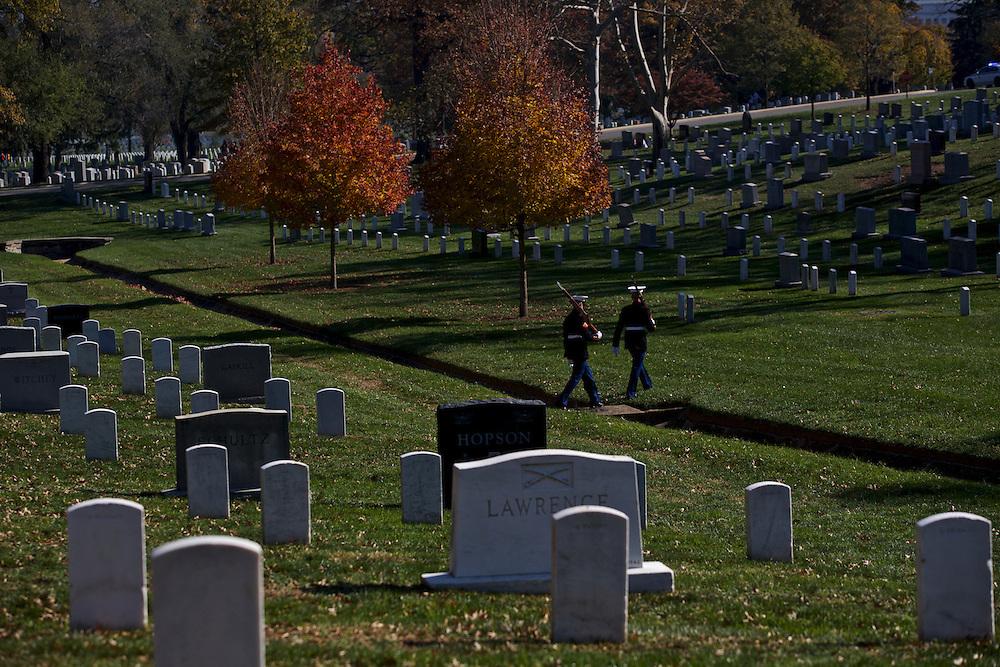 ARLINGTON, VA - NOVEMBER 11: Members of the Marine Corps Honor Guard make their way across Arlington National Cemetery on Veteran's Day November 11, 2012 in Arlington, Virginia.