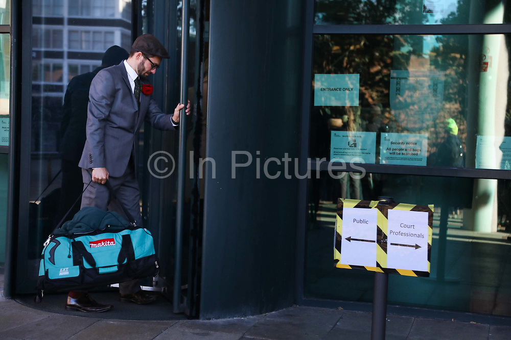"Simon Roscoe Blevins arriving to court with a packed bag, prepared to be sentenced to prison, September 25th, Preston, Lancashire, United Kingdom. Simon Roscoe Blevins, 26,  Richard Roberts, 36 were both sentenced 16 months in prison, Richard Loizou, 31, sentenced 15 months in prison and  and Julian Brock, 47 12 months supended. Simon Roscoe Blevins, 26,  Richard Loizou, 31, Richard Roberts, 36 and Julian Brock, 47 climbed on top of several trucks during a mass protest by locals and supporters in New Preston Road, against fracking in Lancashire, July 2017. The trucks were prevented form delivering equipment to Cuadrillas nearby fracking site for four days. After a seven day jury trial at Preston Crown Court in August 2018, the four men were found guilty of Public Nuisance. Judge Altham has told them to expect ""immediate custodial sentences"" on 25th September 2018."