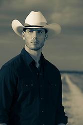 portrait of a hot  cowboy outdoors