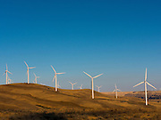 Wind turbines lining the hills in the high desert of eastern Washington State - To license this image, click on the shopping cart below -