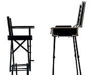 one make up artist suitcase with chair in silhouette on white background