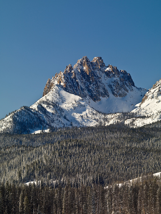 Snow covered Heyburn Peak at 10,112 feet in the Sawtooth Mountain Range in central Idaho is a favorite destination for all season recreation.